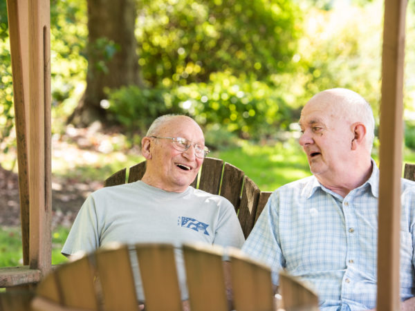 Two residents outdoors talking