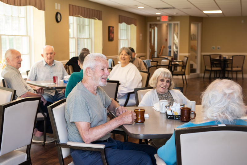 Residents talking together over coffee
