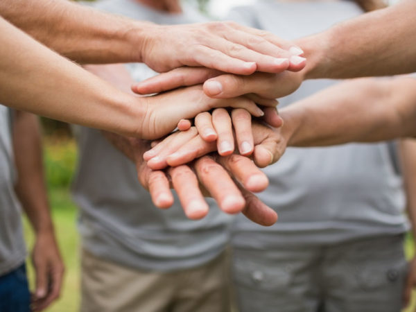 volunteer hands stacked on one another