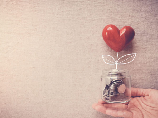 money in jar with red heart