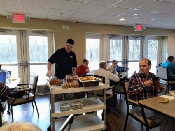 Residents eating donuts for Fasnacht Day